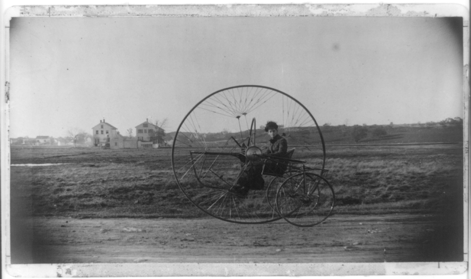 View of Oldreive's new tricycle; the New Iron Horse, with a lady inside