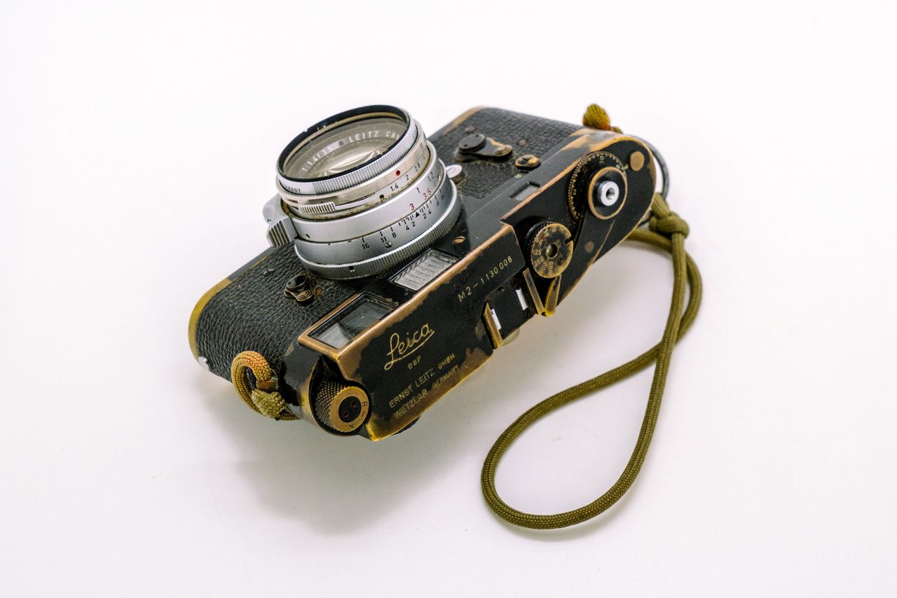 """Sean Flynn's Leica M2, with a """"strap that was hand fashioned from a parachute cord and a hand grenade pin""""."""