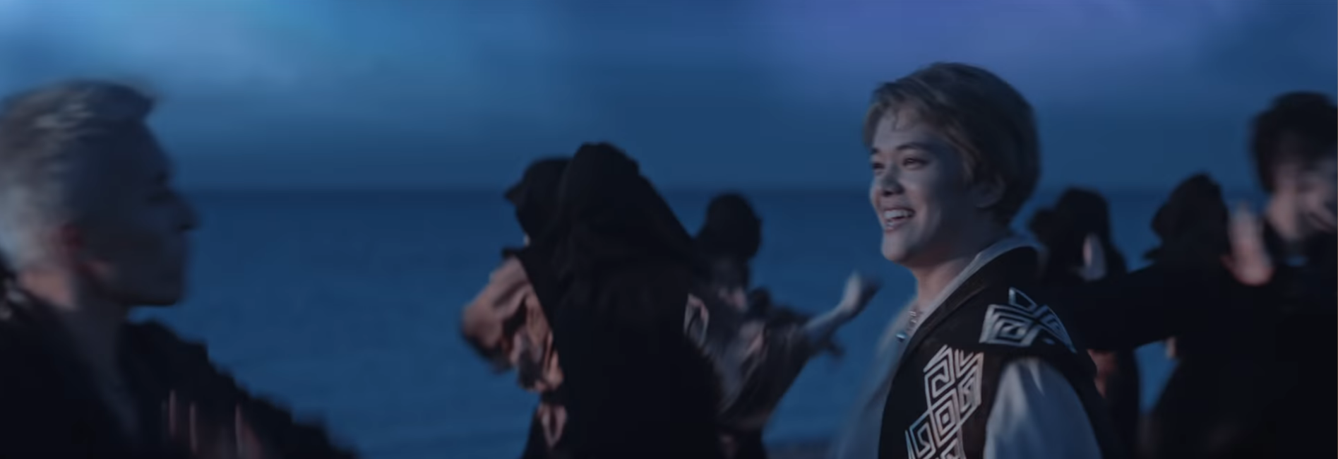Image of Ninety One and backup dancers at night on the beach, with ZaQ at left, Ace in the center (looking to his left and smiling), and Bala at right