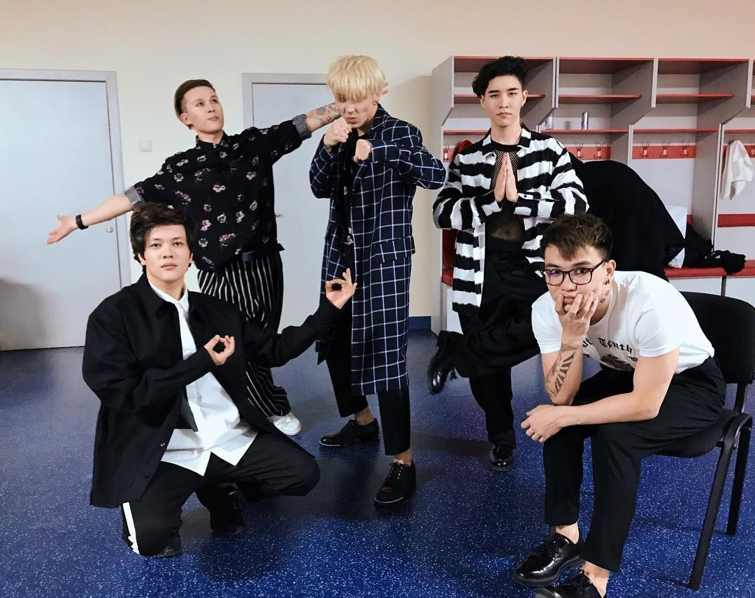 Picture of Ninety One striking silly poses with serious looks on their faces, downloaded from Instagram at some point, probably 2017 judging from the hair and tattoos