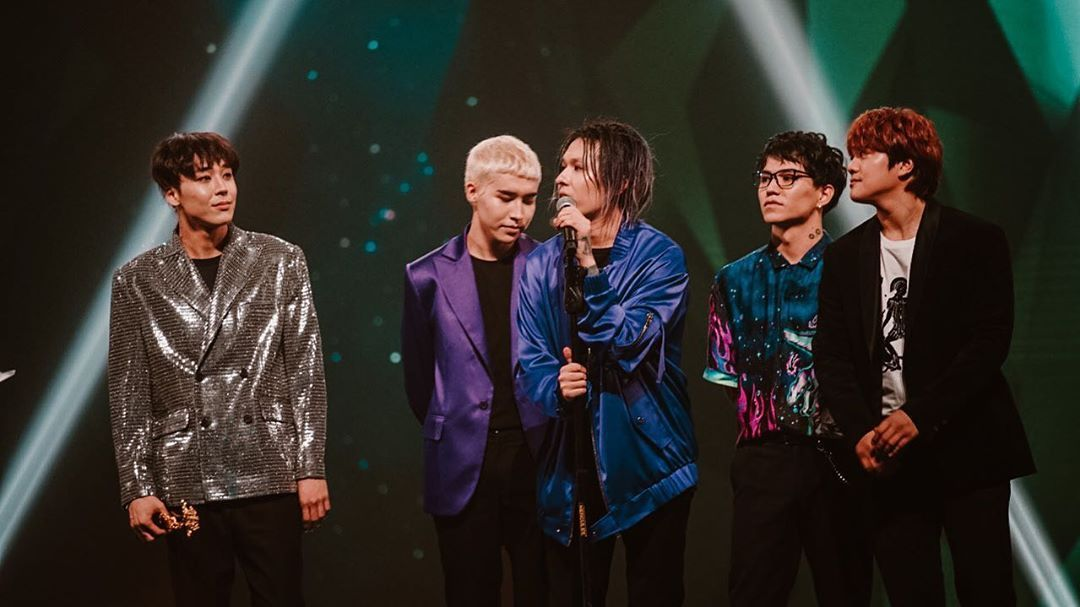 Picture of all five members of Ninety One at a concert in 2019