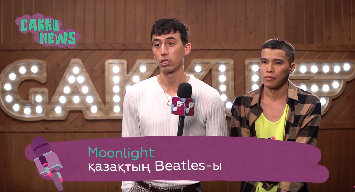 "Image of Ansat and Azamat being interviewed, with a caption that says (I think) ""Moonlight: Kazakhstani Beatles"""