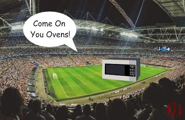 Football fans shouting, 'Come on you ovens!' to a microwave.