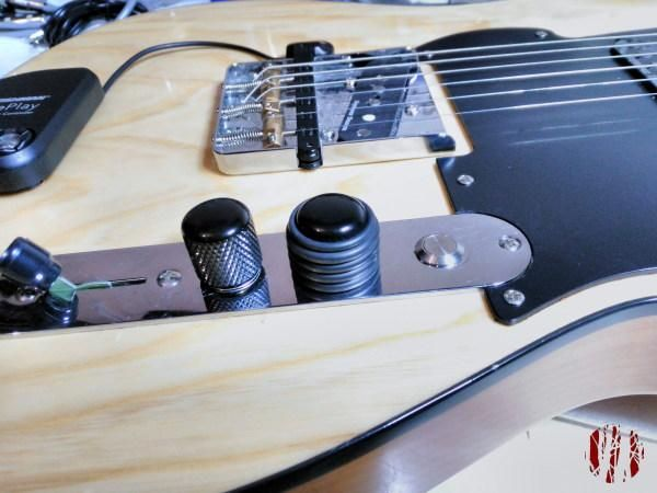 The aforementioned kill switch in the control plate of a Fret-King Telecaster style guitar.