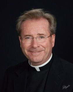 "Father Gary Thomas is a pastor as well as a Vatican-trained exorcist. His story is the basis of the book ""The Rite"", which was later turned into a movie starring Anthony Hopkins. Photo: Copyright LifeTouch/ Sacred Heart Parish. Used with permission."