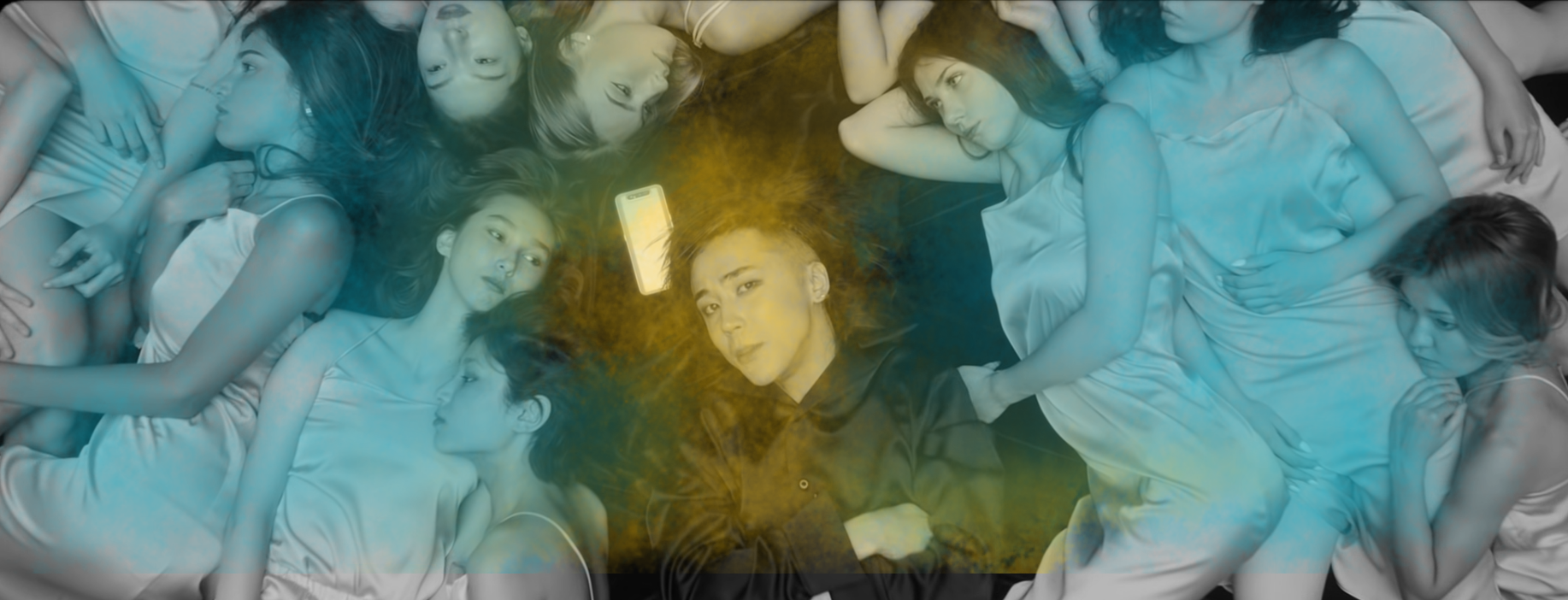 """Image of AZ surrounded by prone women from the """"Men Emes"""" video"""