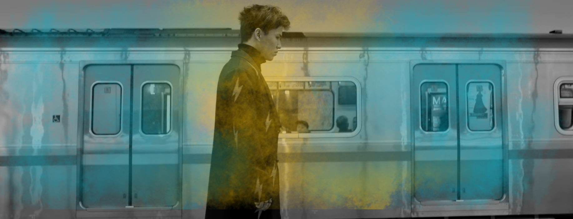 """Image of Alem standing in front of a subway train in the """"Kaytadan"""" video"""