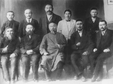Image of ten men dressed formally, five standing and five sitting, in two rows looking at the camera.