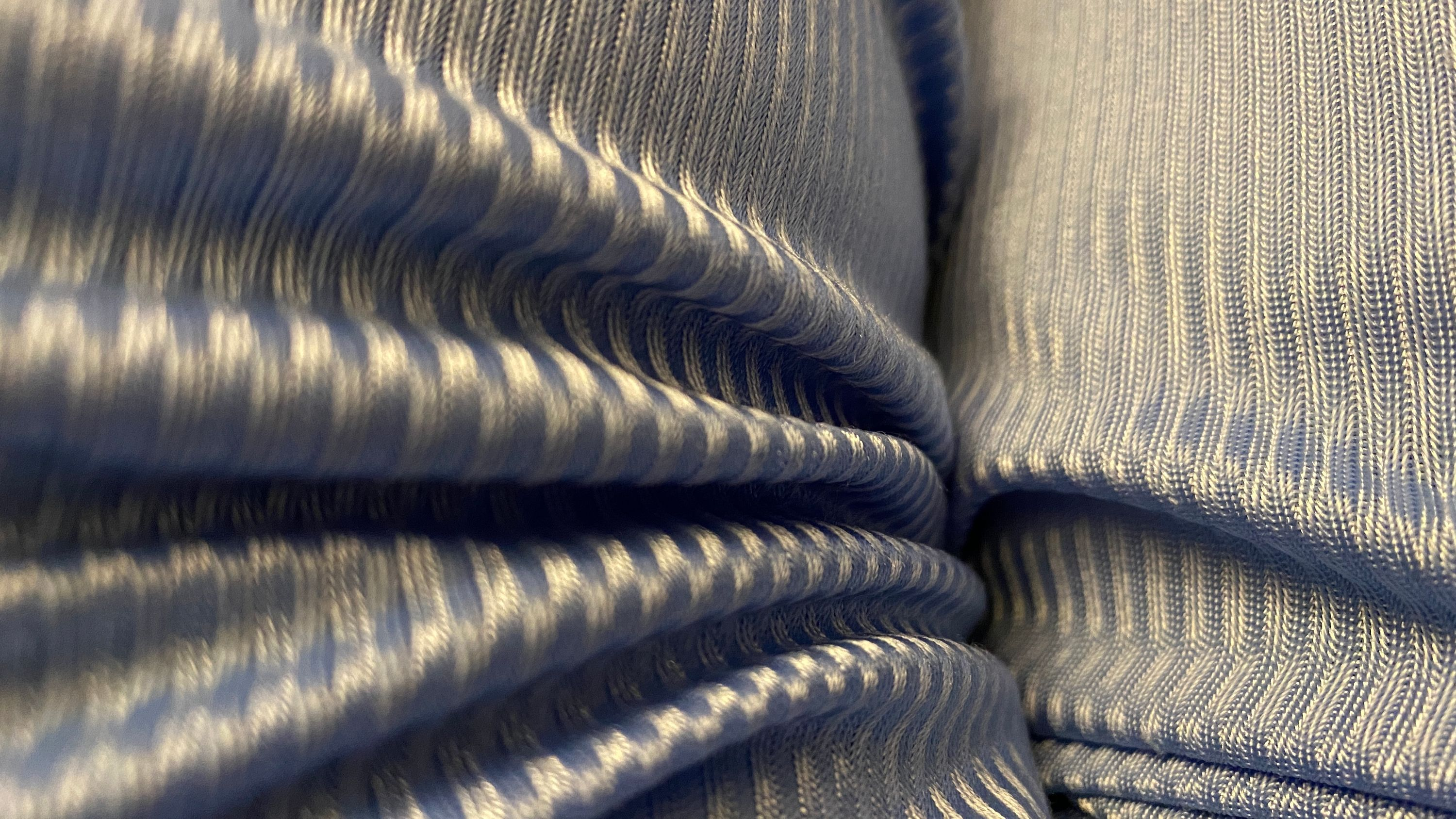 folds in blue polyester