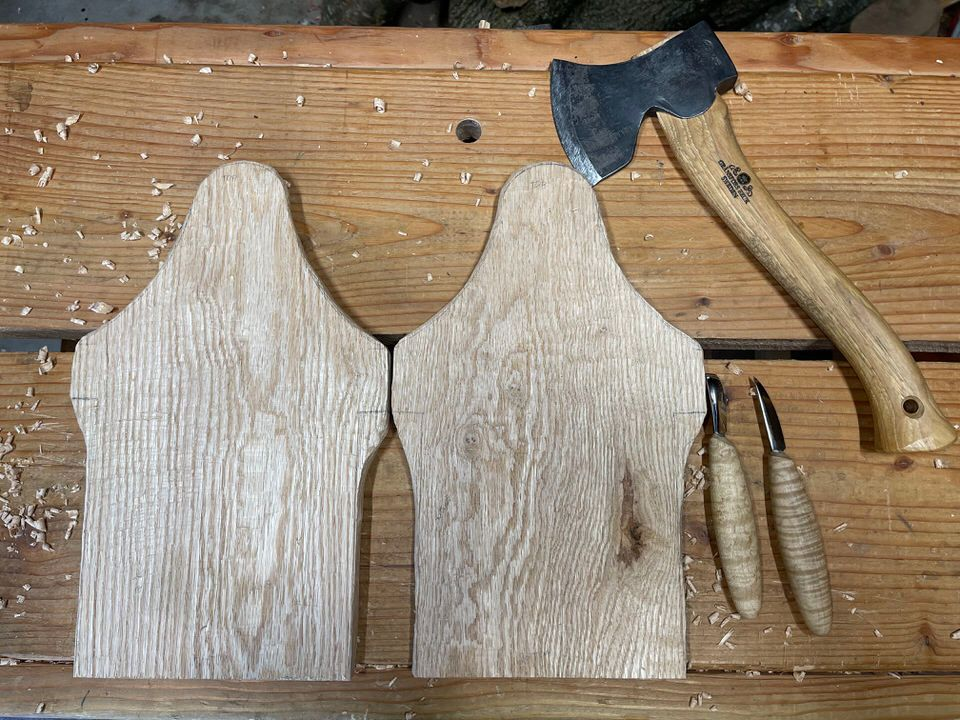 Red Oak parts for a project carved entirely with axe and knife.